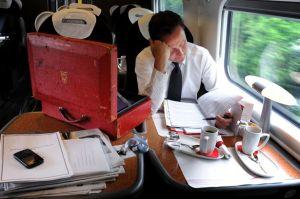David Cameron working on the train